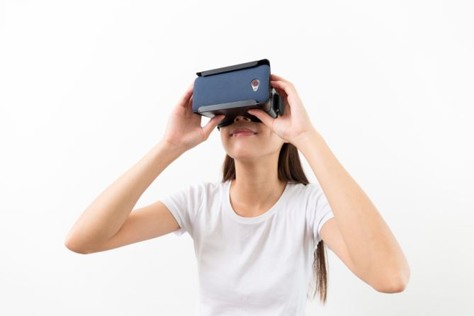 Asian woman watch with VR device